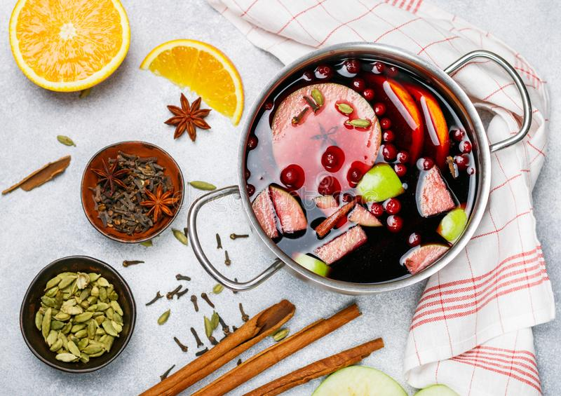 Mulled wine is a traditional winter drink with red wine, honey, orange, green Apple, cranberry and spices stock photos