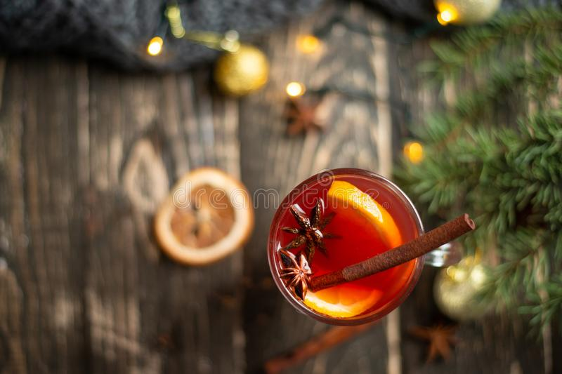 Mulled wine in transparent circles with spices and citrus fruits, top view, flat lay stock images