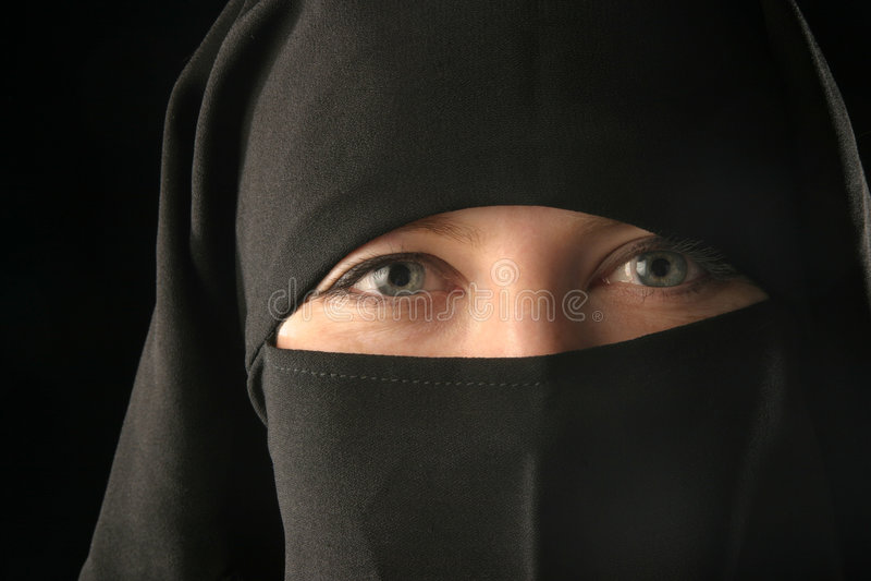 Mulsim woman wearing veil royalty free stock photos