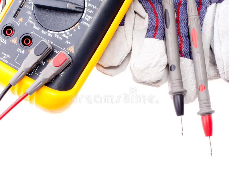 Multímetro, puntas de prueba y guantes de Digitaces imagen de archivo libre de regalías