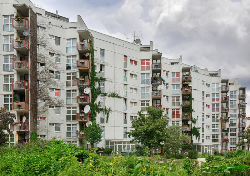 Multi-apartment residential building overgrown with plants. District of Favoriten, Vienna, Austria. VIENNA, AUSTRIA - JULY 22, 2018. Multi-apartment residential royalty free stock images