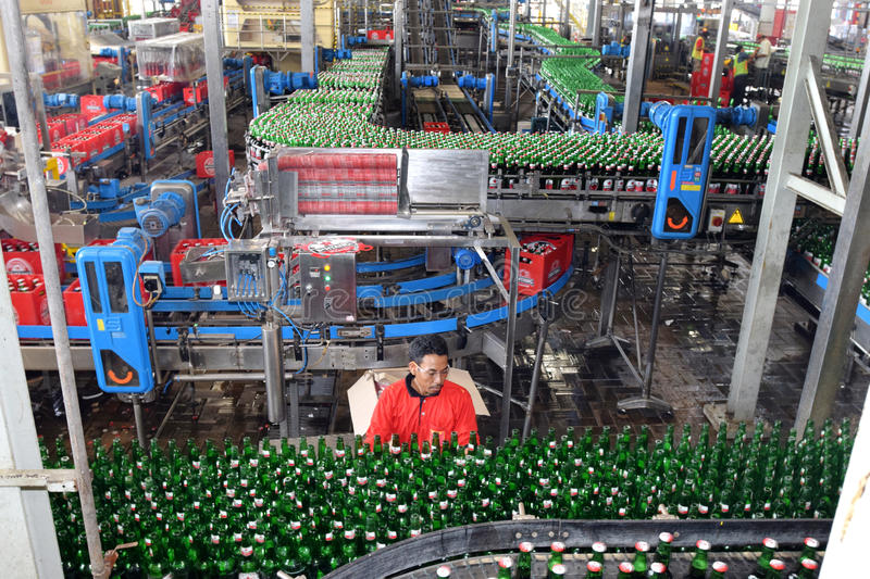 Multi Bintang Indonesia. Production room atmosphere in PT Multi Bintang Indonesia Tbk breweries and bottling facilities in Trawas, Mojokerto, East Java stock image