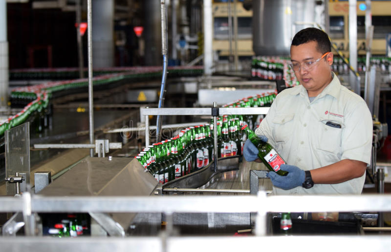 Multi Bintang Indonesia. Production room atmosphere in PT Multi Bintang Indonesia Tbk breweries and bottling facilities in Trawas, Mojokerto, East Java stock images