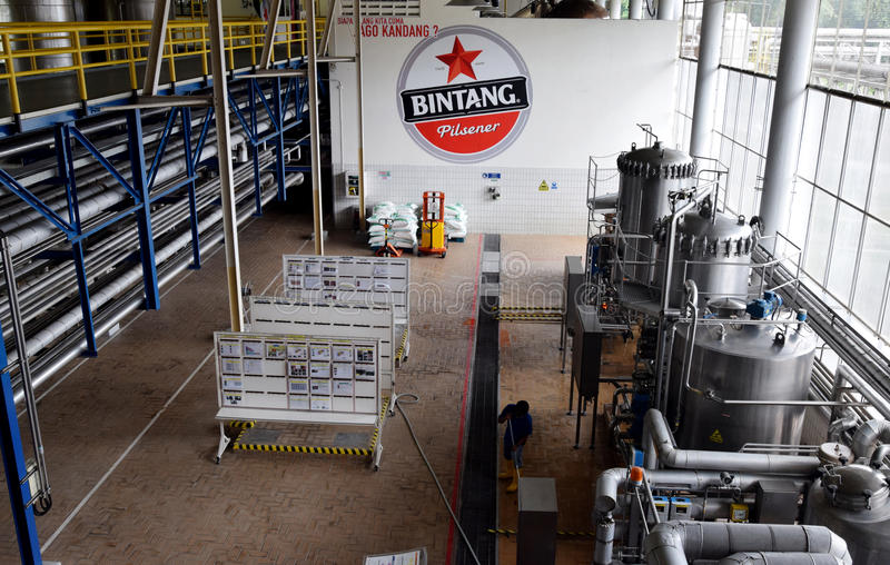 Multi Bintang Indonesia. Production room atmosphere in PT Multi Bintang Indonesia Tbk breweries and bottling facilities in Trawas, Mojokerto, East Java royalty free stock photos