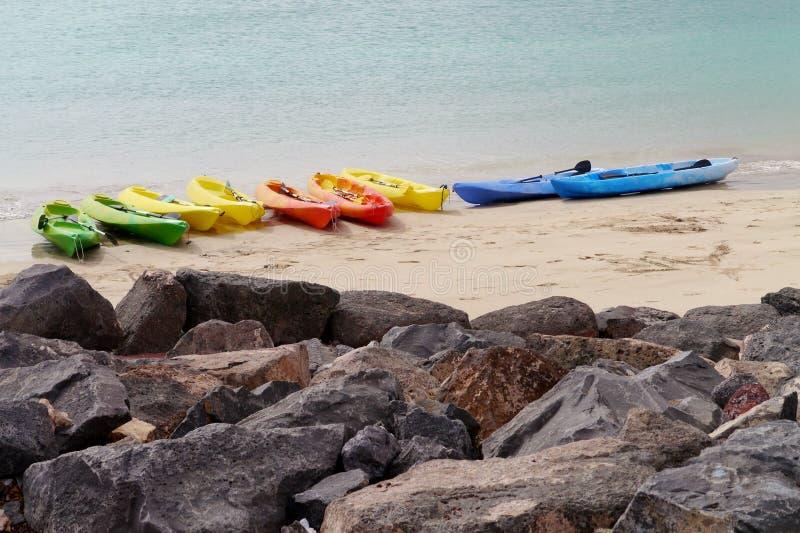Download Multi Canoe Colorate Sulla Costa Di Spamish Fotografia Stock - Immagine di colorful, appartenere: 55360790