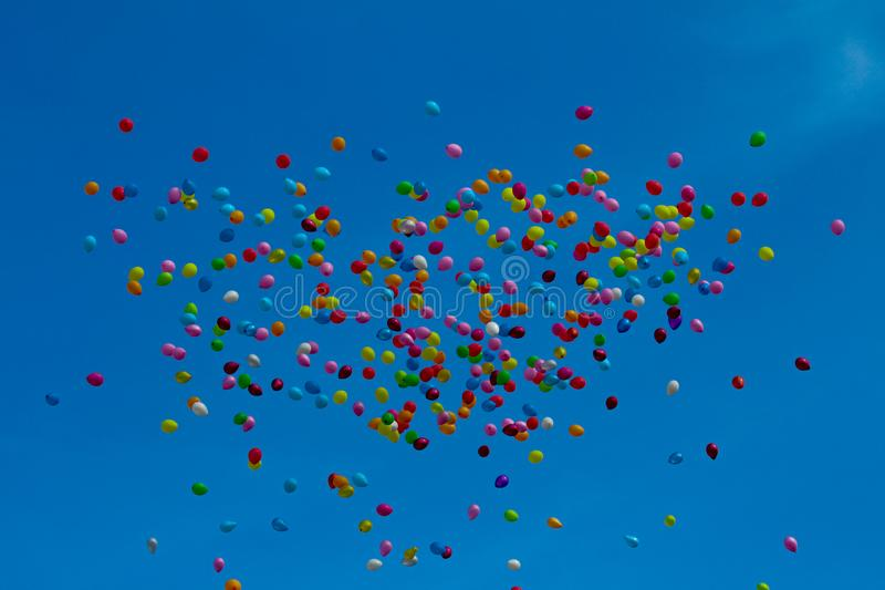 Multi color ballons flying up in to the sky. royalty free stock photos