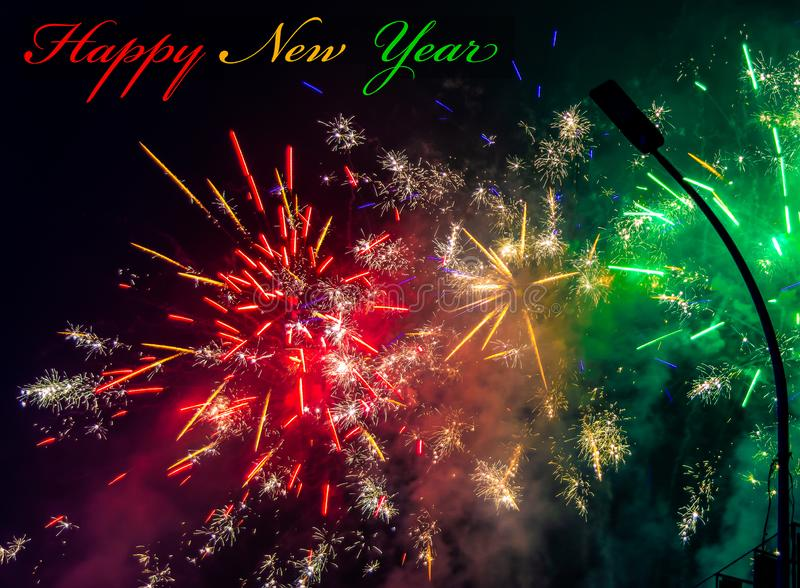 Multi color happy new year text and fireworks for greeting card or template. vivid tone preset royalty free stock photography