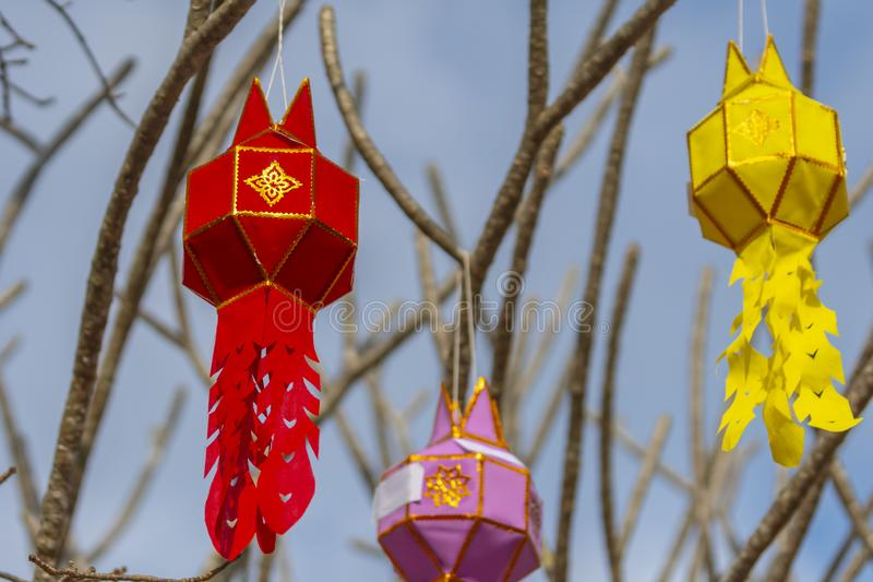 The multi-color of Lanna prayer lanterns decoration on a tree in ceremonies at a Buddhist temple. stock images