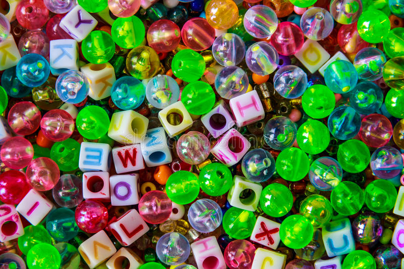 Multi color plastic beads and dices stock photography