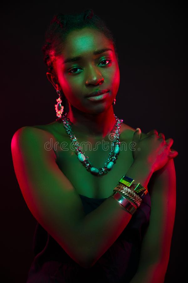 Multi color portrait of confident african woman wearing jewelry stock photography