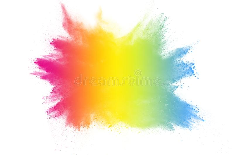 Multi color powder explosion on white background. Bizarre forms of colorful dust particles splash on dark background stock photography