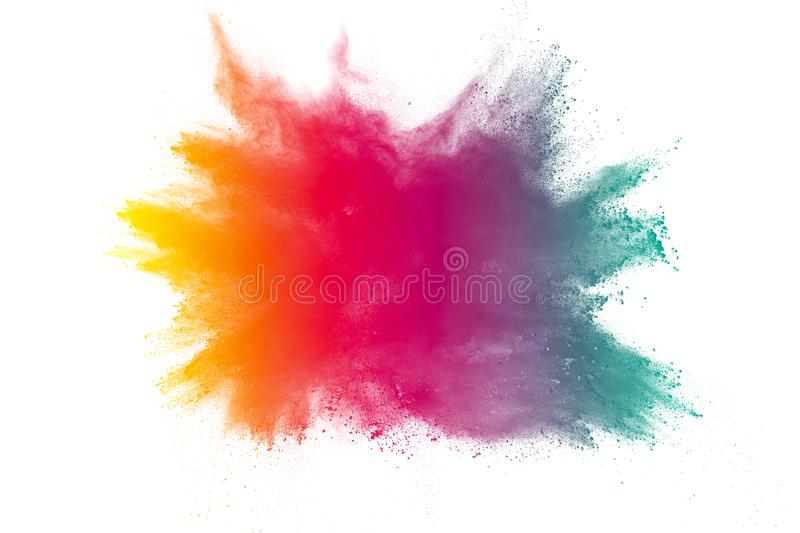 Multi color powder explosion on white background. Bizarre forms of colorful dust particles splash on dark background stock photo