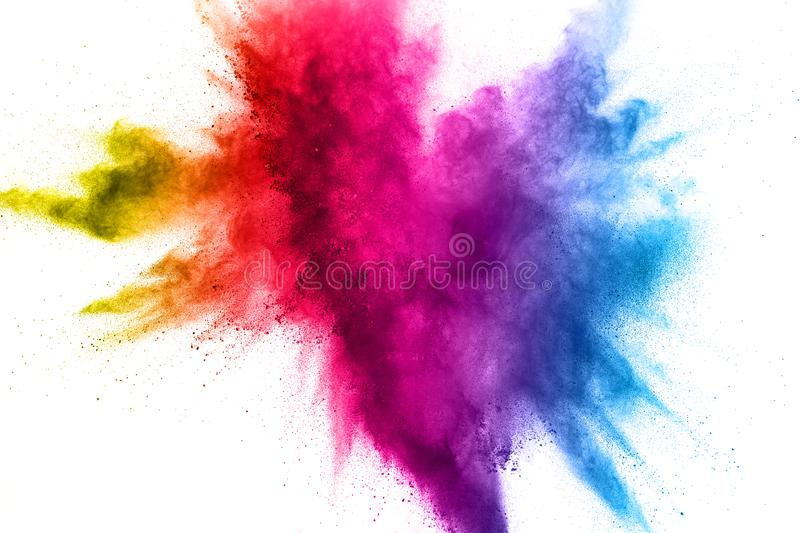 Multi color powder explosion on white background. Bizarre forms of colorful dust particles splash on dark background royalty free stock photos