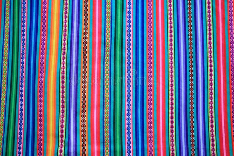 Multi color vivid tone stripe of Peruvian fabric for background royalty free stock images