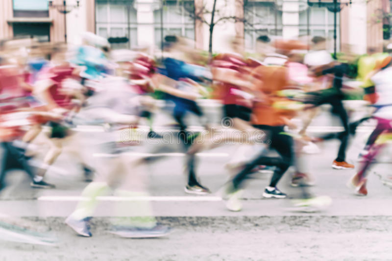 Multi-colored abstract background of group of running athletes on street, city marathon, blur effect, unrecognizable. Multi-colored abstract background of group stock photos