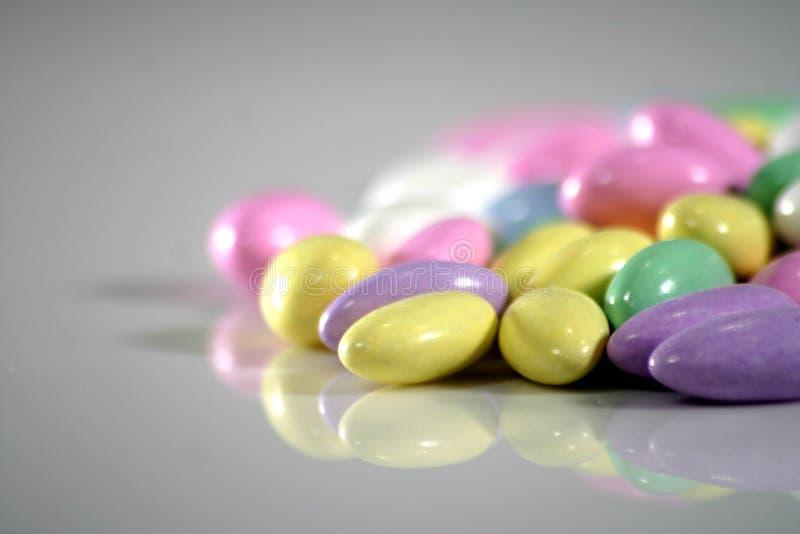 Multi colored almonds stock image