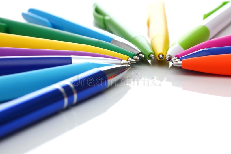 Multi colored ball pens on white background. Multicolored ball point pens isolated on white background royalty free stock photography