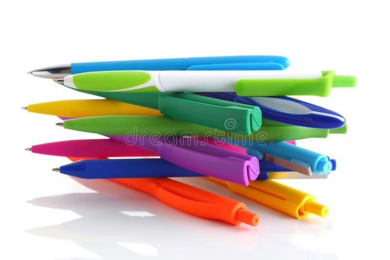 Multi colored ball pens on white background. Multicolored ball point pens isolated on white background royalty free stock image