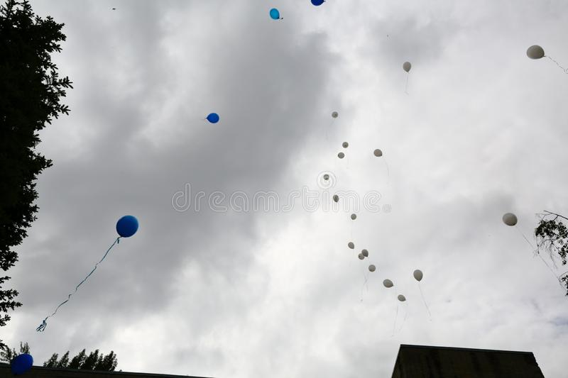Multi-colored balloons that are released in free flight stock photos