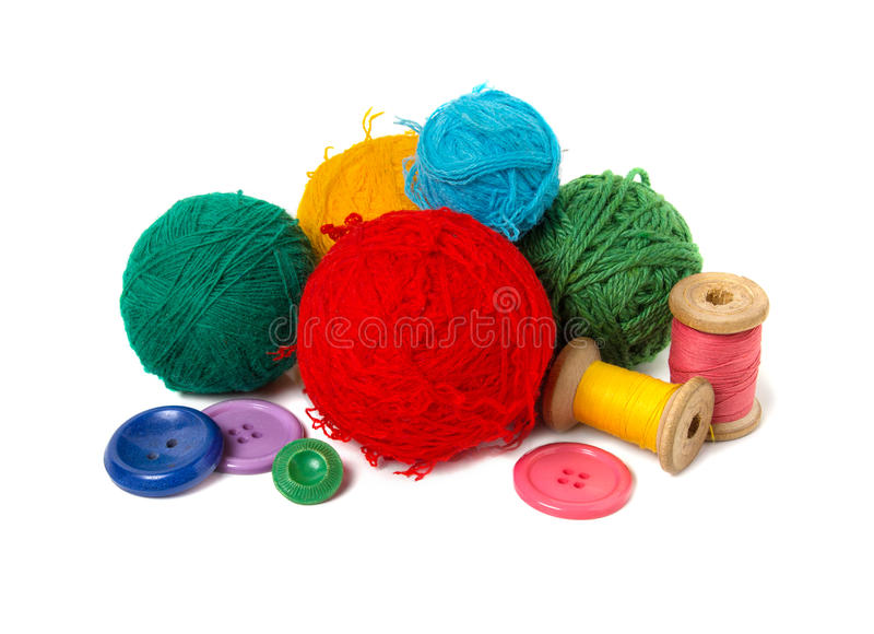 Multi-colored balls, thread and buttons stock photos
