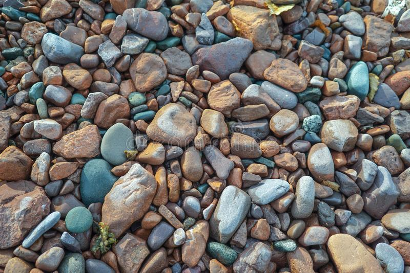 Multi colored beach stones on the shore of Lake Superior, background, texture. Colorful stones on the beaches of Lake Superior in Northern Minnesota, abstract royalty free stock image