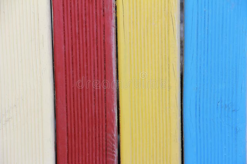 Multi-colored blue white red boards with patterns of cracks and scratches. Multi-colored blue white red boards with patterns of cracks and a scratches stock image