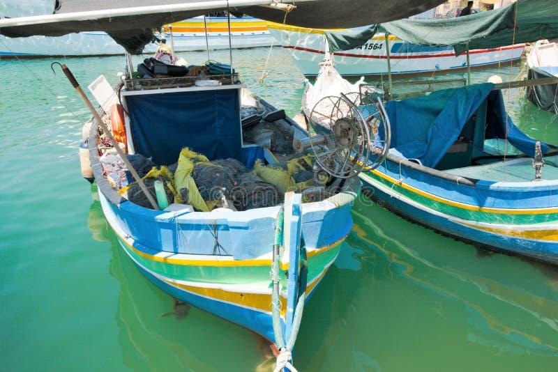 Marsaxlokk, Malta, August 2019. Multi-colored fishing boats ready to go to sea. stock image
