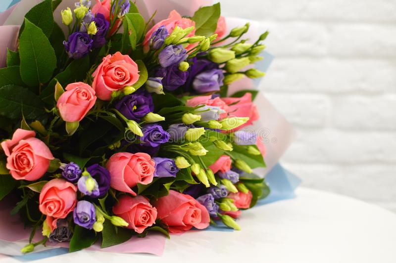 Multi-colored bouquet of flowers on table royalty free stock photography