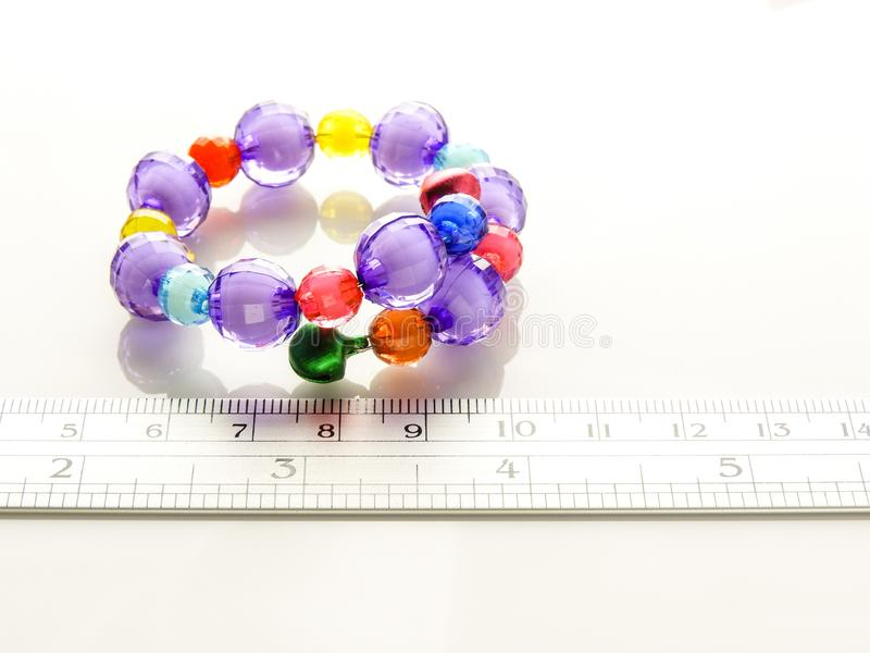 Multi-colored bracelets with beads stock images