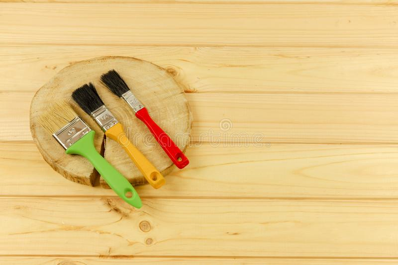 Multi-colored brushes for painting on a wooden base. Flat composition.The tool of the painter royalty free stock photos