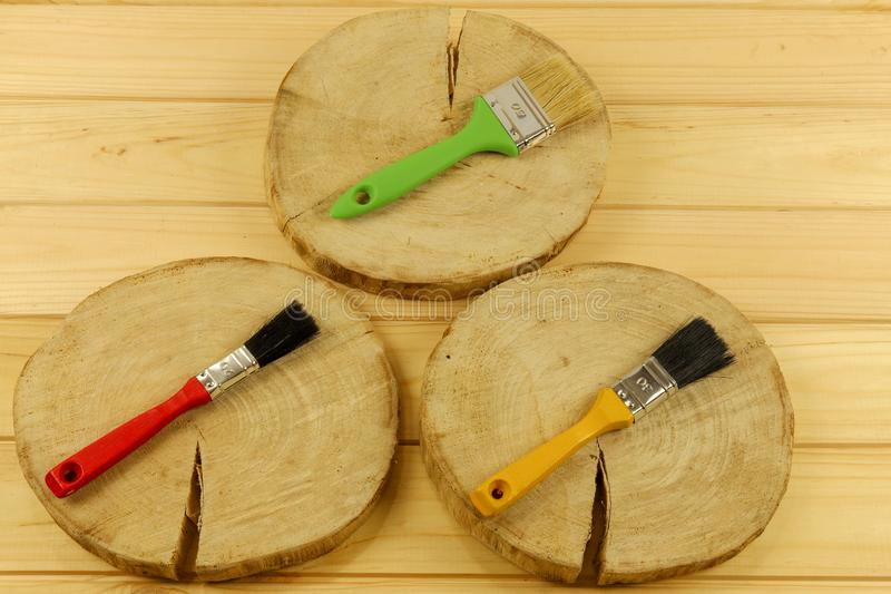 Multi-colored brushes for painting on a wooden base. Flat composition.The tool of the painter stock photography