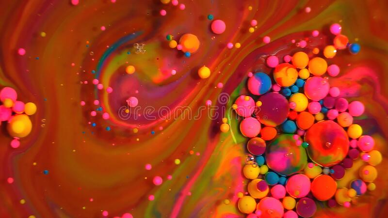 Multi-colored bubbles in the water. Abstract rainbow drops, can be used as background. Vividly beautiful this image is an abstract macro depiction. Still life royalty free stock photos