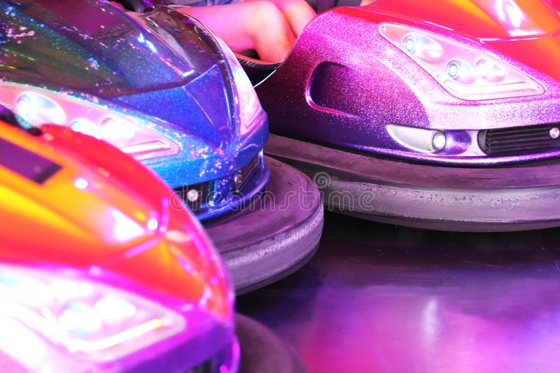 Multi colored bumper cars at a fair stock images