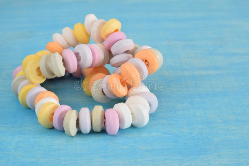Multi colored candy beads in bangle royalty free stock photography