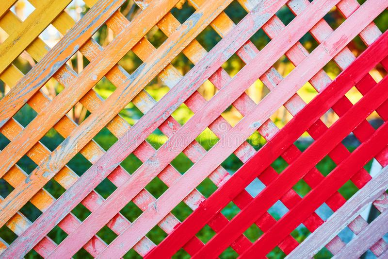 Multi colored checkered wooden fence stock image