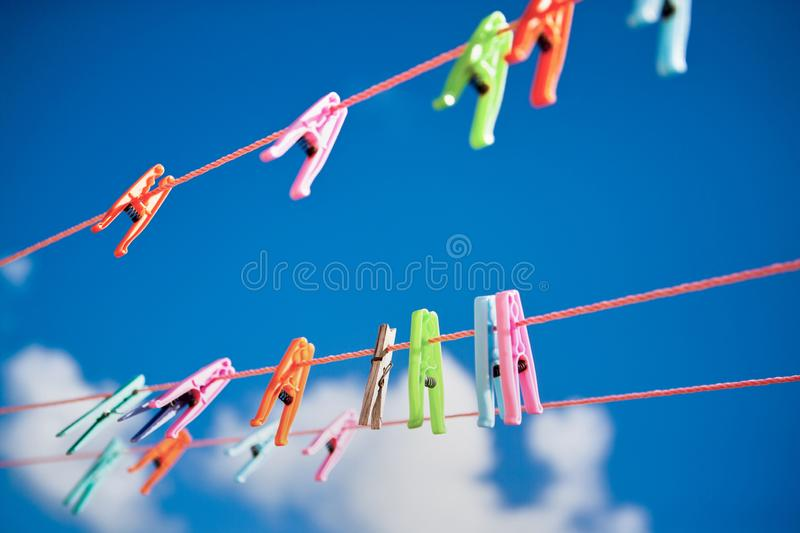 Multi-colored clothespins, in the Dominican Republic. sunny positive image stock photography