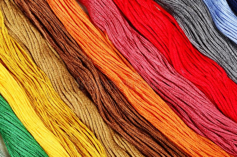 Multi-colored cotton threads for. The background royalty free stock photo