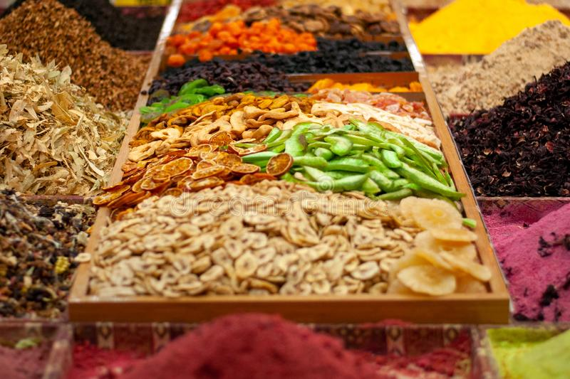 Multi-colored dried fruits and tea in the oriental bazaar. Multi-colored dried fruits and tea in the oriental bazaar stock images