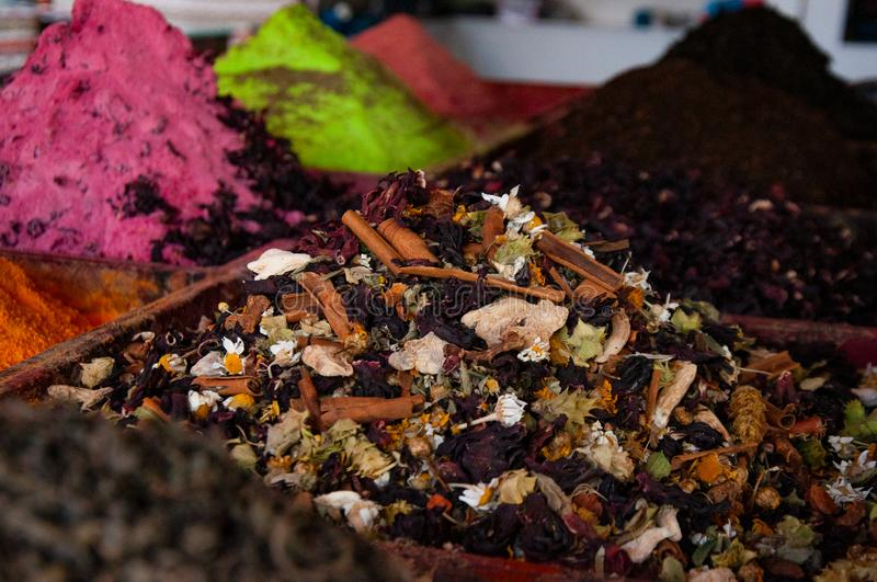 Multi-colored dried fruits and tea in the oriental bazaar. Multi-colored dried fruits and tea in the oriental bazaar stock photos