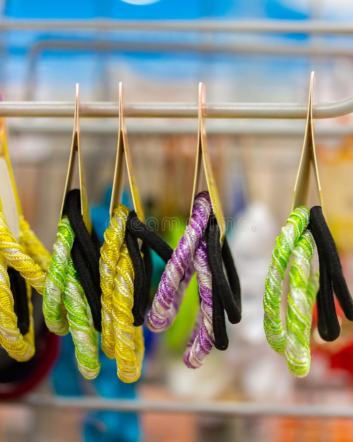 Multi-colored elastic bands for hair, hairpin decoration, hang in the store, vertical royalty free stock photography
