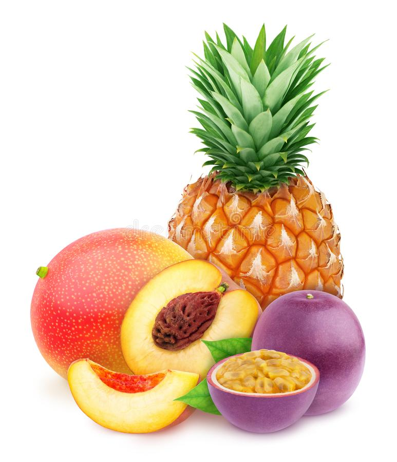 Multi-colored exotic composition with fruit mix of pineapple, passion fruit, peach and mango, isolated on a white background with royalty free stock photography