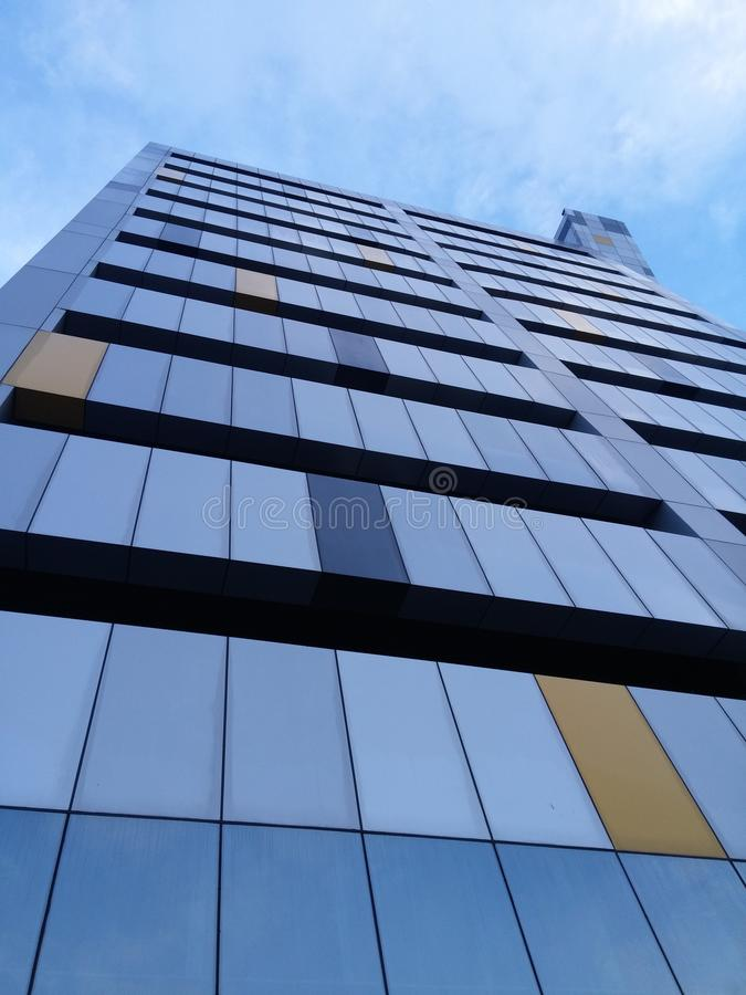 Multi colored face of a high rise building royalty free stock photo