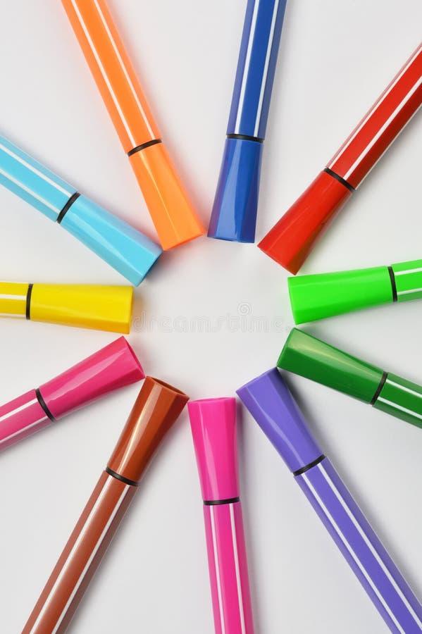 Multi colored felt tip pens on white background. Multi colored felt tip pens isolated on white royalty free stock images