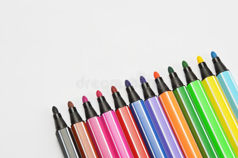 Multi colored felt tip pens on white background. Multi colored felt tip pens isolated on white stock photography