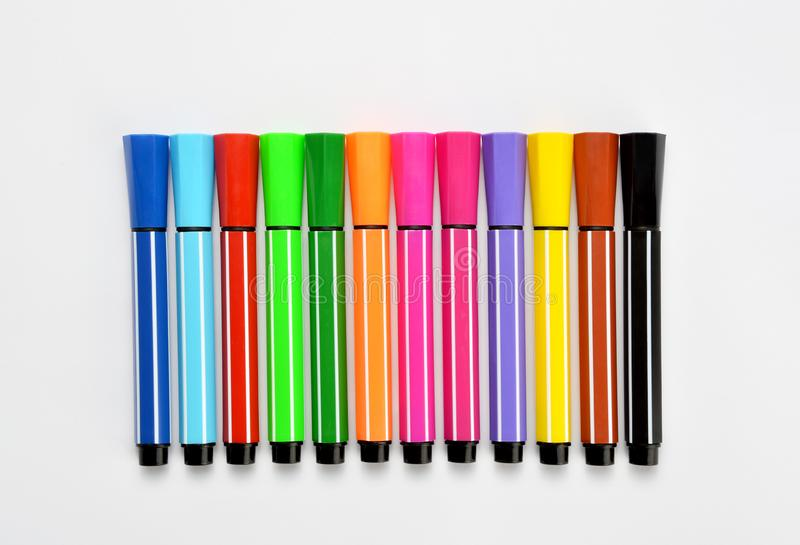 Multi colored felt tip pens on white background. Multi colored felt tip pens isolated on white stock image