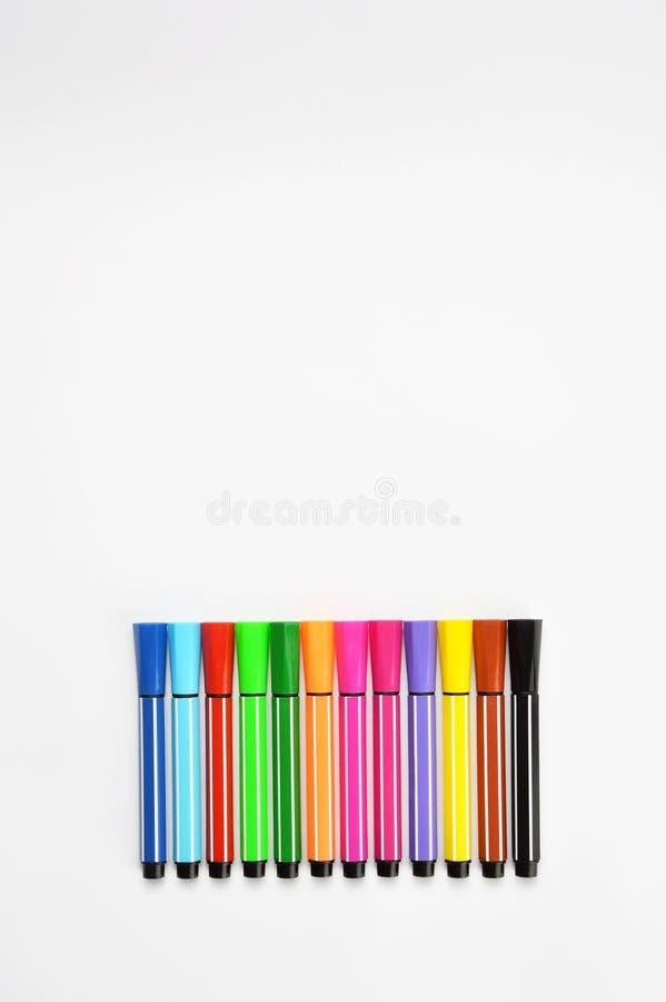 Multi colored felt tip pens on white background. Multi colored felt tip pens isolated on white royalty free stock image