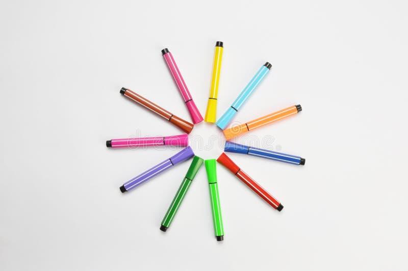 Multi colored felt tip pens on white background. Multi colored felt tip pens isolated on white royalty free stock photos