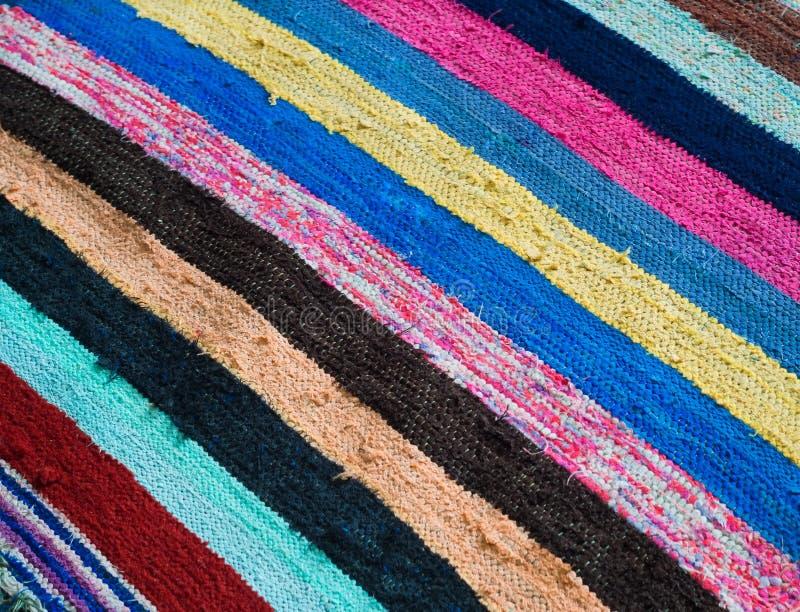 Multi-colored gestreepte deken stock afbeelding