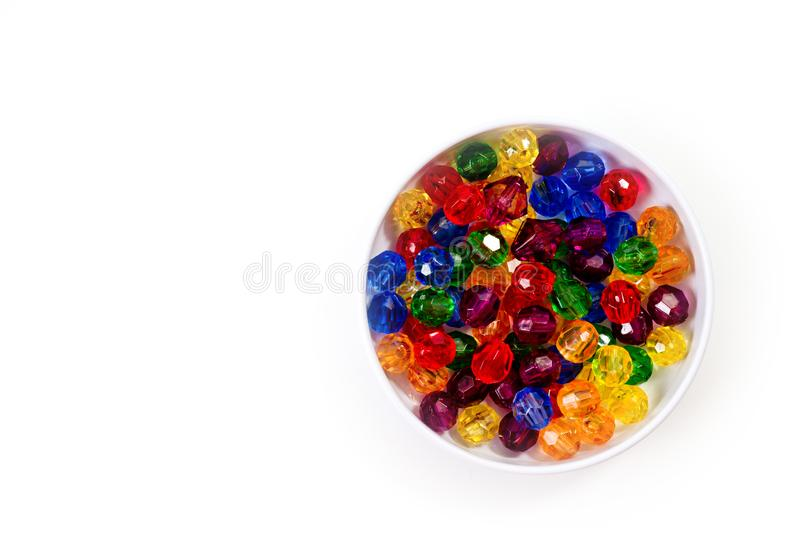 Multi-colored glass beads for beads and bracelets shot large on a white background stock photo