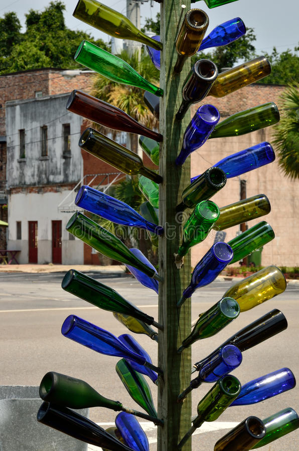 Multi-colored glass bottle tree stock photography